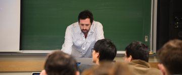Arthur Gill Green teaching at class
