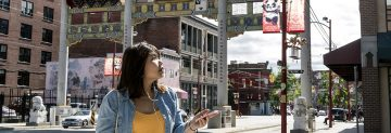 UBC alumna Ernielly Leo uses an augmented reality app to tour Vancouver's historic Chinatown neighbourhood. Developed by UBC professor Siobhán McPhee and students, the app is a historical walking tour that uses geolocation and audio files to enhance a user's experience. (Photo by Abigail Saxton)
